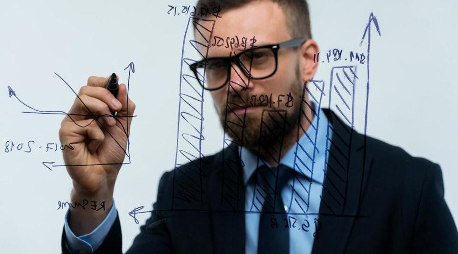 man-draws-various-growth-charts-calculating
